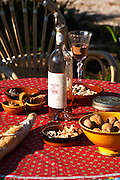 Aperitif and appetizers prepared on a Provencal table: bread, olives, walnuts nuts, Domaine du Loou Coteau Varois en Provence Clos des Iles Le Brusc Six Fours Cote d'Azur Var France