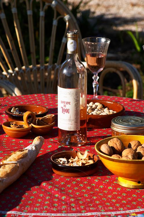 Aperitif and appetizers prepared on a Provencal table: bread, olives, walnuts nuts, Domaine du Loou Coteau Varois en Provence Clos des Iles Le Brusc Six Fours Cote d'Azur Var France