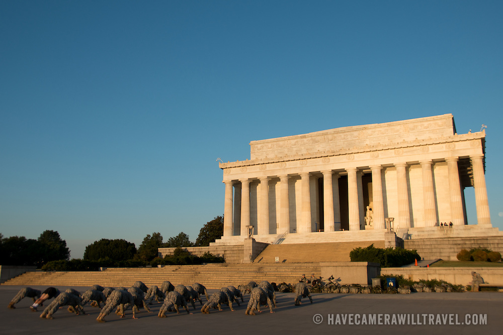 Soldiers from a nearby military base do their early morning fitness training at the base of the Lincoln Memorial in Washington DC.