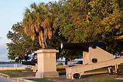 Statue of revolutionary war hero William Moultrie and a Confederate columbiad canon in White Point Gardens along the battery in Charleston, SC.