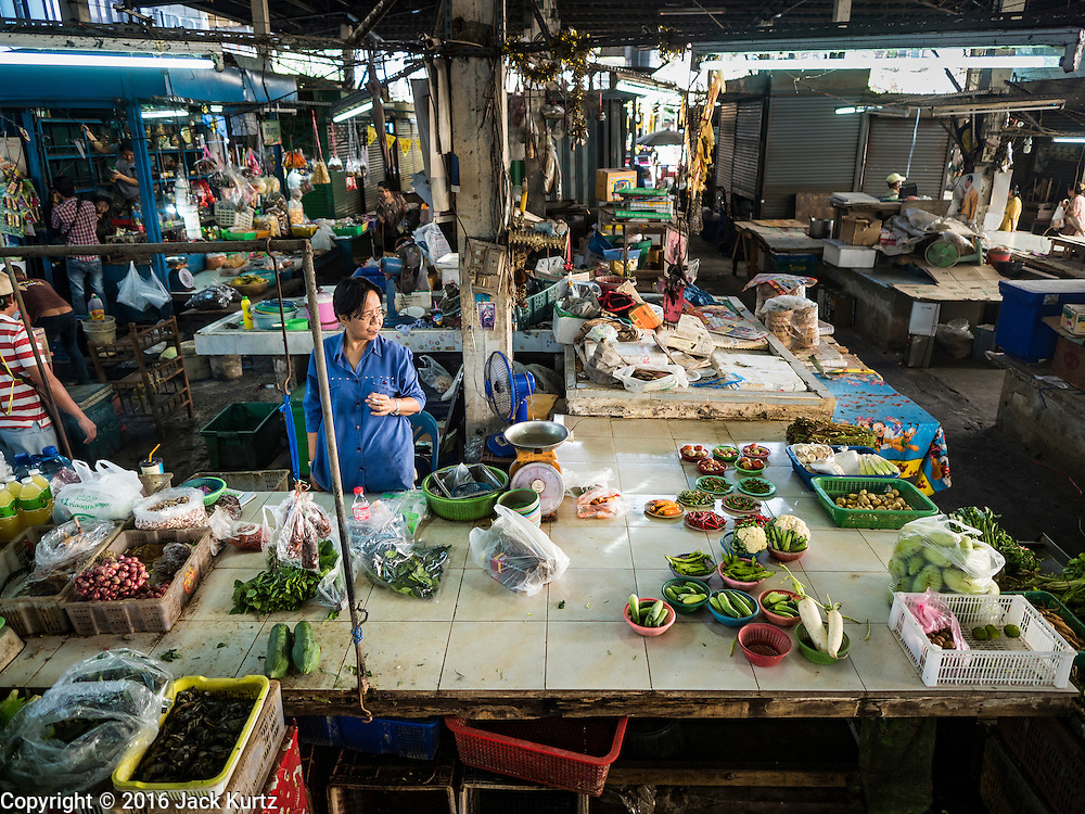 04 JANUARY 2016 - BANGKOK, THAILAND:        One of the few vendors left in Bang Chak Market with the last of the produce she was selling. The market closed January 4, 2016. The Bang Chak Market serves the community around Sois 91-97 on Sukhumvit Road in the Bangkok suburbs. About half of the market has been torn down. Bangkok city authorities put up notices in late November that the market would be closed by January 1, 2016 and redevelopment would start shortly after that. Market vendors said condominiums are being built on the land.     PHOTO BY JACK KURTZ
