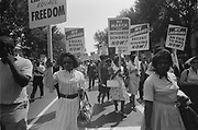 Civil rights march on Washington, DC, USA.  Procession of African Americans carrying placards demanding equal rights, integrated schools, decent housing, and an end to bias.  28 August 1963. Photographer:  Warren K  Leffler.