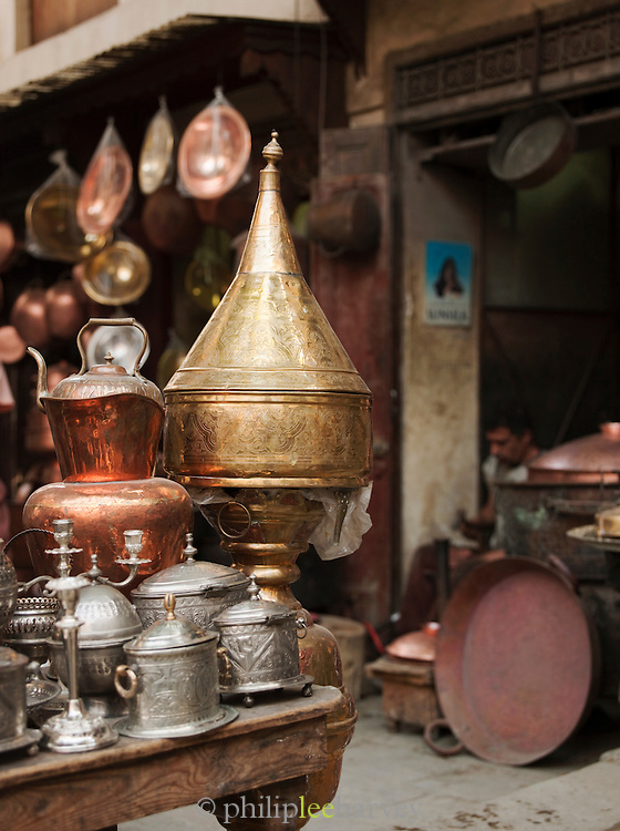 Metal works for sale at a shop in the narrow streets of the medina, Fes, Morocco
