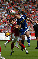 Photo: Tony Oudot.<br /> Charlton Athletic v Leicester City. Coca Cola Championship. 22/09/2007.<br /> Stephen Clemence of Leicester City challenges Zheng Zhi of Charlton to the ball