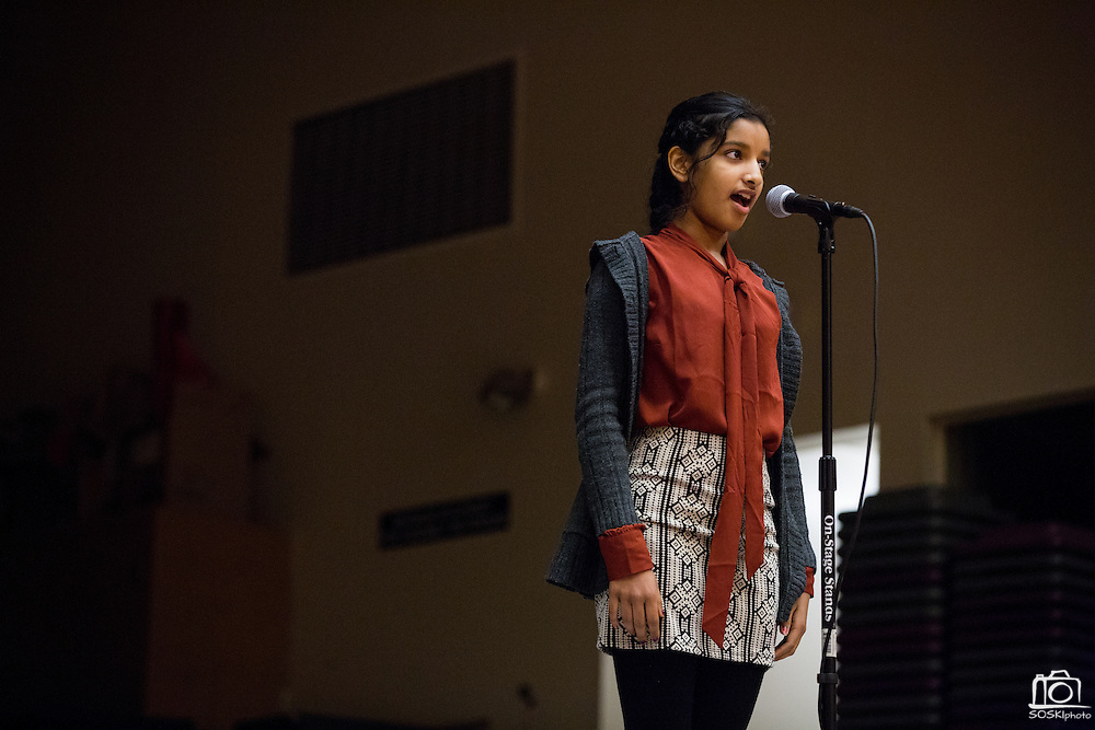Eighth grader Swetha Nair confidently spells a word during the 1st Annual Spelling Bee at Rancho Middle School in Milpitas, California, on December 9, 2015. (Stan Olszewski/SOSKIphoto)