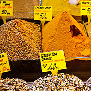 A range of spices available for sale at the famous Spice Bazaar (also known as the Egyption Bazaar) in Istanbul, Turkey. This particular display is for tourists--the prices are in English.