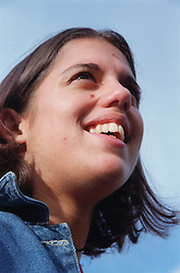 Portrait of teenage girl with physical disability smiling,