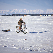 """Daily life at Ust-Barguzin, a port town along the shore at Russia's Lake Baikal. Crowned the """"Jewel of Siberia"""", Baikal is the world's deepest lake, and the biggest lake by volume, holding 20% of the world's fresh water. In the winter, the lake 31,722 square meter surface is entirely frozen with ice averaging 2 meters thick."""