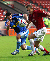 Photo: Dave Linney.<br />Walsall v Wycombe Wanderers. Coca Cola League 2. 14/10/2006.Walsall'sMartin Butler(R) battles with  Matt Bloomfield.