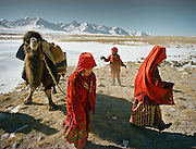Every morning, the girls from the Khan's camp are in charge of getting water all throughout winter in sub zero temperature. They have to dig hole in the ice to hope and find the spring that always freezes overnight..Qyzyl Qorum campment, Abdul Rashid Khan's camp (leader of the Afghan Kyrgyz).