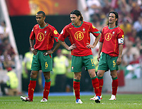 Fotball<br /> EURO 2004<br /> Portugal<br /> 12.06.2004<br /> NORWAY ONLY<br /> <br /> Hellas v Portugal<br /> <br /> Foto: Scott Heavey/Digitalsport<br /> <br /> From Left to Right: Costinha - Maniche and Fernando Couto feel dejected after Greece score their second
