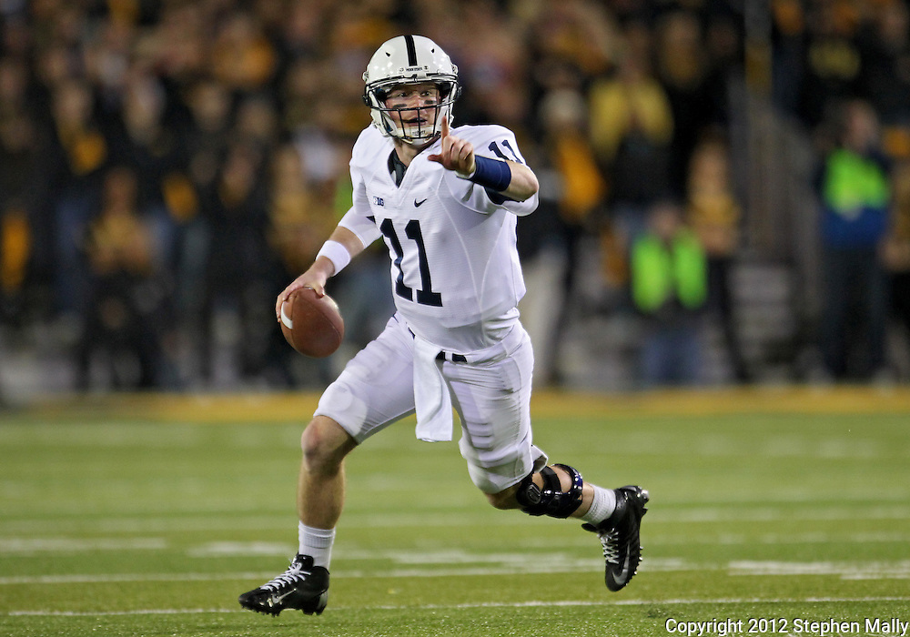 October 20 2012: Penn State Nittany Lions quarterback Matthew McGloin (11) points to a receiver before throwing a touchdown pass during the first half of the NCAA football game between the Penn State Nittany Lions and the Iowa Hawkeyes at Kinnick Stadium in Iowa City, Iowa on Saturday October 20, 2012. Penn State defeated Iowa 38-14.