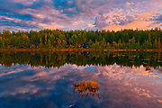 Reflection of clouds in northern lake at sunrise.<br />Greater Sudbury<br />Ontario<br />Canada