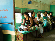 Inside a carriage on the Yangon Circular Railway, Myanamar. The railway, a narrow gauge local commuter rail network serving Yangon metropolitan area is a 28.5 mile (45.9 km) 39 station loop system. This British built rail-loop connects Yangon to its satellite towns and villages.