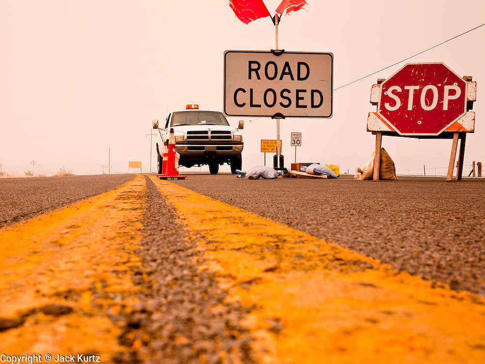 """04 JUNE 2011 - EAGAR, AZ: The roadblock on Highway 261 because of the Wallow Fire. The fire grew to more than 140,000 acres early Saturday with zero containment. A """"Type I"""" incident command team has taken command of the fire.   PHOTO BY JACK KURTZ"""