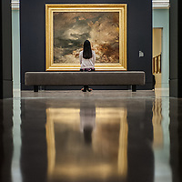 London, UK - 8 September 2014: a gallery assistant looks up at 'A disaster at sea, 1835' <br />  by J.M.W. Turner, during the press preview of The EY Exhibition: Late Turner – Painting Set Free exhibition at Tate Britain