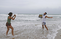 Javier Narvaez poses for as his daughter Juliana, left, takes a photo at Miami Beach as the outer bands of Hurricane Irma reach South Florida early on Saturday, September 9, 2017. Photo by David Santiago/El Nuevo Herald/TNS/ABACAPRESS.COM