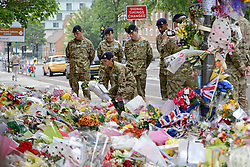 © London News Pictures. 31/05/2013. Woolwich, UK. Cadets from the Royal Artillery barracks in Woolwich laying flowers and paying their respects at the scene where Drummer Lee Rigby was killed in Woolwich, South East London. Photo credit: Ben Cawthra/LNP