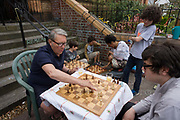 Campaigners locked out of the closed Carnegie Library play chess outside, in Herne Hill, south London on 7th May 2016. For ten days, members of the community in the south London borough occupied their important resource for learning and social hub for the weekend. But after a long campaign by locals, Lambeth have gone ahead and closed the librarys doors because they say, cuts to their budget mean millions must be saved. A gym is planned to replace the working library and while some of the 20,000 books on shelves will remain, no librarians will be present to administer it. London borough's budget cuts mean four of its 10 libraries will either close, move or be run by volunteers.