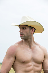 Portrait of a hot shirtless cowboy