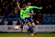 Gillingham FC defender Gabriel Zakuani (6) and Cardiff City midfielder Callum Paterson (13)  during the The FA Cup 3rd round match between Gillingham and Cardiff City at the MEMS Priestfield Stadium, Gillingham, England on 5 January 2019. Photo by Martin Cole.