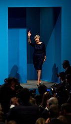 © Licensed to London News Pictures. 04/10/2017. Manchester, UK. British prime minister THERESA MAY arrives on stage to deliver her leaders speech on the final day of the Conservative Party Conference. The four day event is expected to focus heavily on Brexit, with the British prime minister hoping to dampen rumours of a leadership challenge. Photo credit: Ben Cawthra/LNP