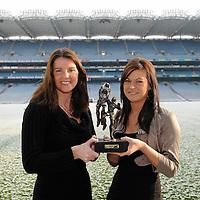 29 November 2010; Sinead Kelly who was presented with the Lucozade Sport/Irish Independent Player of the Month for October by Siobhan Glennon, left, Lucozade Sport, at a luncheon in Dublin. The West Clare Gaels full back was in superb form in the month of October with a number of fantastic defensive displays mixed with exciting forward runs. Sinead picked up two player of the match awards during October, her first in the Munster Intermediate final and the second in the All-Ireland Intermediate quarter final against Parnells in London. West Clare Gaels recently won the Intermediate final against St Conleths of Laois helped by yet another superb performance from Sinead. Croke Park, Dublin. Picture credit: Brendan Moran / SPORTSFILE *** NO REPRODUCTION FEE ***