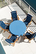 terrace of a penthouse, blue table with chairs, top view
