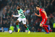 Odsonne Edouard (#22) of Celtic brings the ball forward pursued by Andrew Considine (#4) of Aberdeen during the Betfred Cup Final between Celtic and Aberdeen at Celtic Park, Glasgow, Scotland on 2 December 2018.