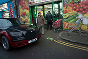 Scene outside a fruit and vegetable market in Shadwell, East London, England, UK. This area is very much at the heart of the Asian and primarily Bangladeshi community in the multicultural area close to Whitechapel.