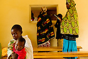 Patients visit the Uwikingi Health Center in the Nyamagabe District of Rwanda's Southern Province. The center was built in 2009, opened in 2010, and now serves a population of 23,000 people. The Mudasomwa Area Development Program (ADP) located here is one of many long-term development initiatives led by the international nonprofit World Vision. Area Development Programs work within communities like Nyamagabe over a period of several years, providing developmental resources to foster long-term, sustainable growth in the economic and physical well being of the community.