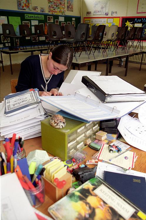 Teacher marking books after school,