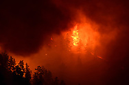 """The Sunshine Canyon fire in Boulder, CO happened on the early morning of March 19, 2017, during """"the snowiest month of the year,"""" according to many a local.  There were """"red flag"""" warnings prior to this fire, and rumors spoke of campers on the edge of town as the cause.  Climate change has altered Colorado's winters to the point that red flag warning days happen throughout the year, no matter the season.  <br /> <br /> Clouds of smoke from higher on the ridge cause this passing-moment peep hole into the burning forest within.    Very Eye of Sauron... gazing on the forest to be burned.<br /> <br /> The full gallery of Boulder Sunshine Canyon Fire images can be seen under said name in the menu or here: http://www.climatephotography.com/index/G0000Tc4Jr1bE1xs."""