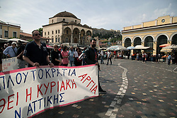 May 6, 2017 - Athens, Attica, Greece - Protestors with banner against work on Sundays, demonstrate at Monastiraki square, at the foothills of Acropolis in central Athens, Greece on Sunday May 7, 2017. In the new agreement between the Greek government and international  lenders, in the context of reforms, all shops will be open 32 Sundays, from May to October  (Credit Image: © Panayotis Tzamaros/NurPhoto via ZUMA Press)