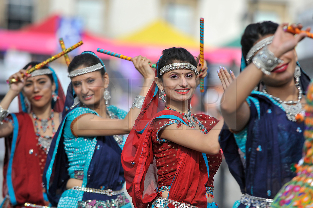 © Licensed to London News Pictures. 15/10/2017. London, UK. Traditional garba dancers perform at Diwali, the 'Festival of Lights', in Trafalgar Square.  Hosted by Sadiq Khan, Mayor of London, organisers present a variety of cultural activities and entertainment for visitors to enjoy.  Diwali is observed annually by Hindus, Sikhs and Jains in India and many other countries around the world.   Photo credit : Stephen Chung/LNP