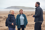 Rhossili Bay, Swansea, Wales, UK. Tuesday 21 August 2018.  Former Wales rugby international Jamie Roberts, with Lucy O'Donnell (centre) and Eirlys Thomas, National Trust Wales nature ambassadors.<br /> <br /> Good friends Lucy (53) and Eirlys (67), who have taken 100 days, on and off, to complete the Wales Coastal Path, share their story as part of National Trust Wales' campaign, to find ambassadors with special stories connected to nature around Wales. The campaign is fronted by former Wales rugby star Jamie Roberts.