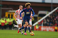 Marouane Fellaini of Man Utd breaks away from Charlie Adam of Stoke city.  Premier league match, Stoke City v Manchester Utd at the Bet365 Stadium in Stoke on Trent, Staffs on Saturday 21st January 2017.<br /> pic by Andrew Orchard, Andrew Orchard sports photography.