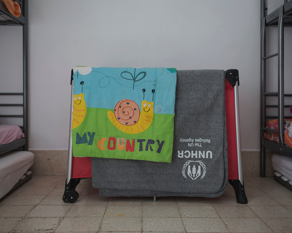 A child's cot bed in one of the rooms in Villa Artemis, a shelter for 30 refugee women and their children in the grounds of Leros Hospital. <br /> <br /> Opened in September 2015, the shelter was run by the Leros Solidarity Network. However, Villa Artemis was closed down shortly after the opening of a 'Hotspot' (EU-run migrant's reception centres) camp in Lepida in February 2016.