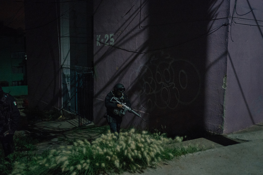 A member of the municipality police patrols a public housing complex in Guadalupe, Zacatecas state, Mexico, on August 8, 2020. In Mexico, municipal police are amongst the security forces with the lowest salaries, which according to analysts, has contributed to their accepting bribes from criminal groups.