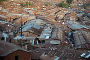 Nearly a million people live in makeshift houses made of plastic, cardboard and corrugated iron sheets in the Kibera slum, Africa's largest slum settlement located in Nairobi, Kenya. (From the book What I Eat: Around the World in 80 Diets.)