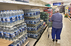 © Licensed to London News Pictures 23/07/2021. Sidcup, UK. Some bottled water stock has arrived filling empty shelves at Sidcup Tesco in South East London. Shoppers continue to seeing a shortages in supermarkets today as supplies have been hit by staff being forced to self-isolate. Photo credit:LNP