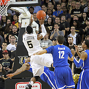 Central Florida guard Marcus Jordan (5) drives to the basket against a Memphis defender during a Conference USA NCAA basketball game between the Memphis Tigers and the Central Florida Knights at the UCF Arena on February 9, 2011 in Orlando, Florida. Memphis won the game 63-62. (AP Photo: Alex Menendez)
