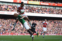 Brighton & Hove Albion's Bruno Saltor prevents Arsenal's Pierre-Emerick Aubameyang getting to the ball