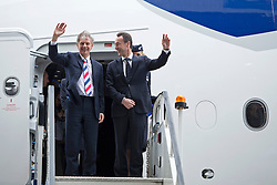 © London News Pictures. 04/07/2013 . London, UK.  Left to Right - Keith Williams, CEO of British Airways and Fabrice Bregier, President and CEO of Airbus  leave the British Airways  Boeing A380 superjumbo as it arrives at Heathrow Airport. It was the first time British Airlines have taken delivery of the new plane, making British Airways the first European airline to operate both the 787 and A380. Photo credit : Ben Cawthra/LNP