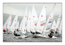 The second day of racing at the World Laser Radial Youth Championships, Largs, Scotland...Carnage at windward mark of the Blue flight with Guillermo Altadill ESP 165786 at the centre...317 Youth Sailors from 42 different nations compete in the World and European Laser Radial Youth Champiponship from the 17-25 July 2010...The Laser Radial World Championships take place every year. This is the first time they have been held in Scotland and are part of the initiaitve to bring key world class events to Britain in the lead up to the 2012 Olympic Games. ..The Laser is the world's most popular singlehanded sailing dinghy and is sailed and raced worldwide. ..Further media information from .laserworlds@gmail.com.event press officer mobile +44 7866 571932 and +44 1475 675129 .