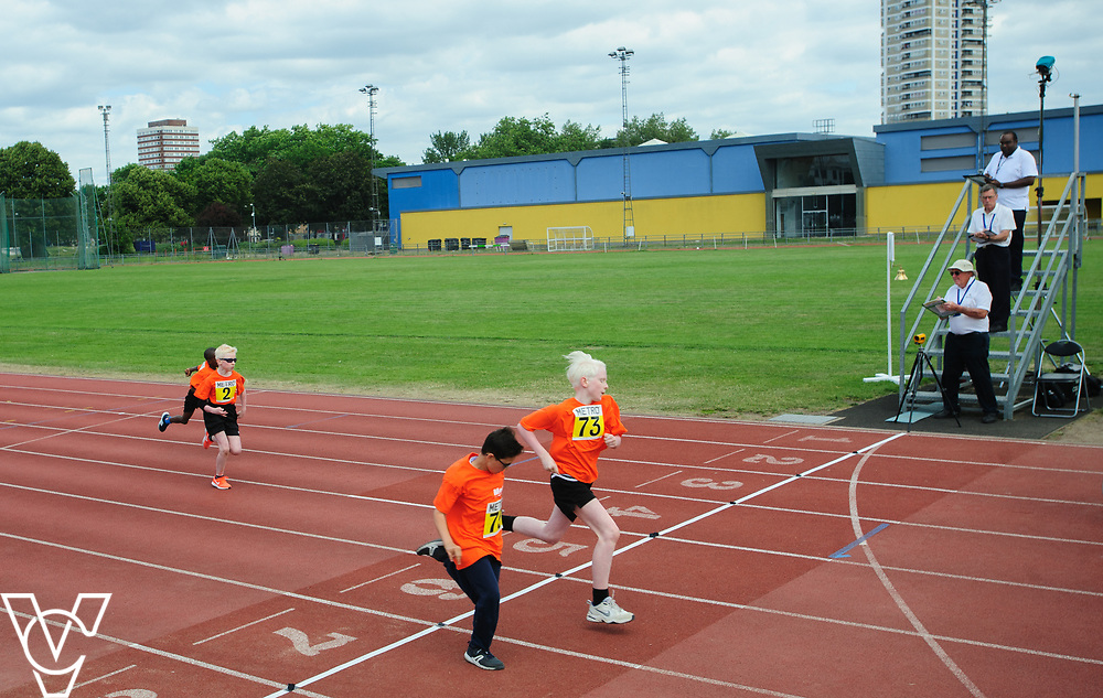 Event: 60 meters<br /> Competitors, from left: Competitor #75 and Eoin Quigley<br /> <br /> Metro Blind Sport's 42nd Athletics Open, held at Mile End Stadium, Tower Hamlets, London.<br /> <br /> Picture: Chris Vaughan Photography for Metro Blind Sports<br /> Date: June 16, 2018
