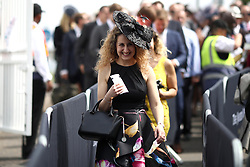 A female racegoer arrives during ladies day of the 2018 Investec Derby Festival at Epsom Downs Racecourse, Epsom.