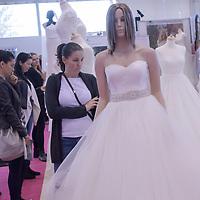 Visitors watch wedding dresses during Wedding Expo in Budapest, Hungary on Nov. 04, 2017. ATTILA VOLGYI