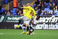 Bolton Wanderers' Neil Danns tackles Brentfords' Alex Pritchard. Skybet football league championship match, Bolton Wanderers v Brentford at the Macron stadium in Bolton, Lancs on Saturday 25th October 2014.<br /> pic by Chris Stading, Andrew Orchard sports photography.