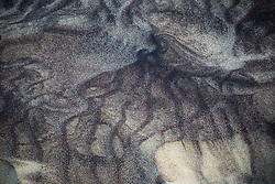 detail of patterns in the sand